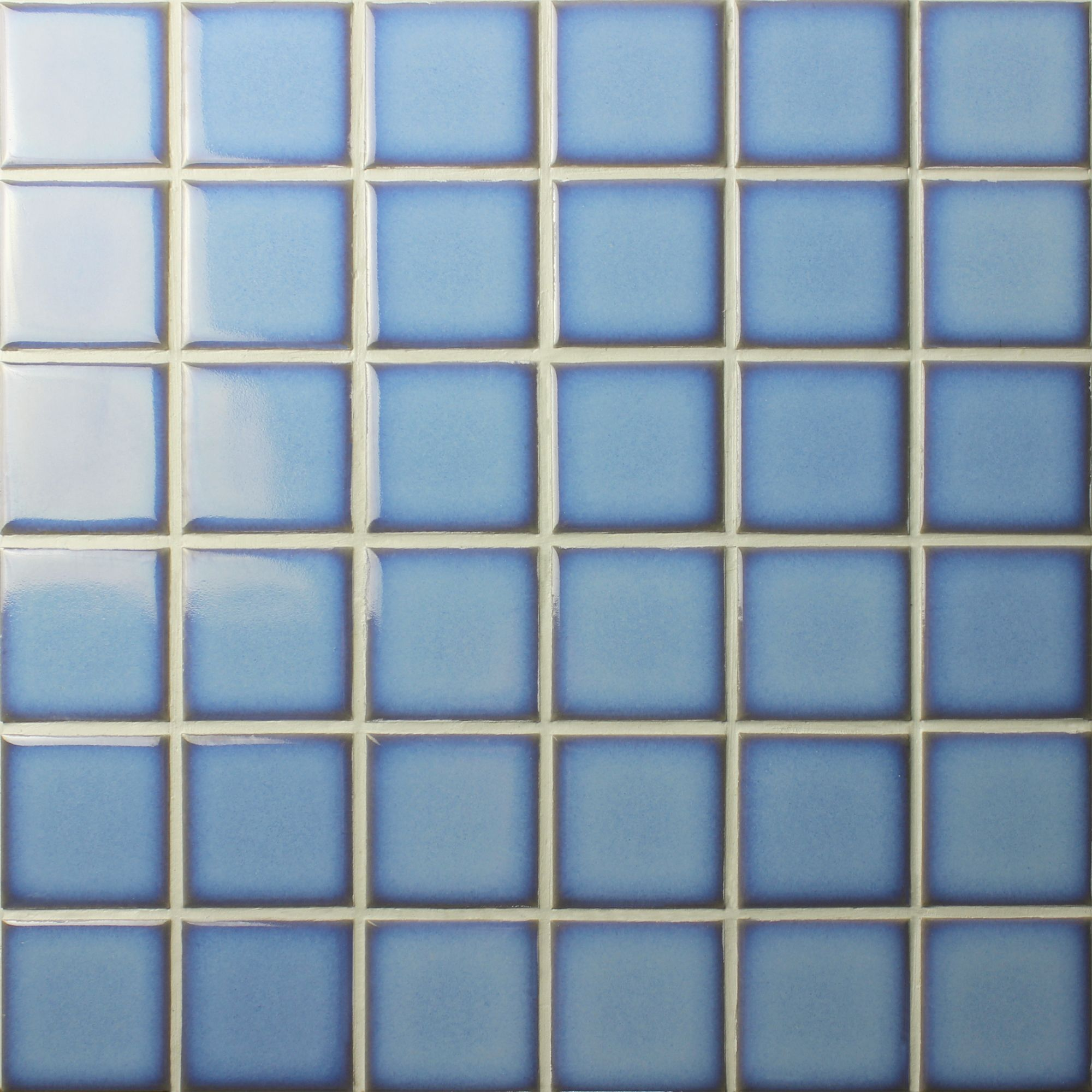 A pale blue ceramic mosaic with a darker edge details is the hot ...