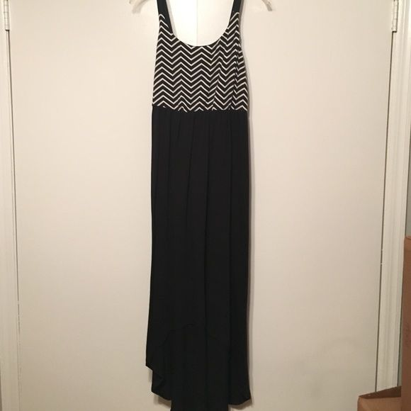 MAXI DRESS Black and white chevron print on top and plain black on the bottom. Stretchy material. Straps are black elastic. Good condition. Xhilaration Dresses Maxi