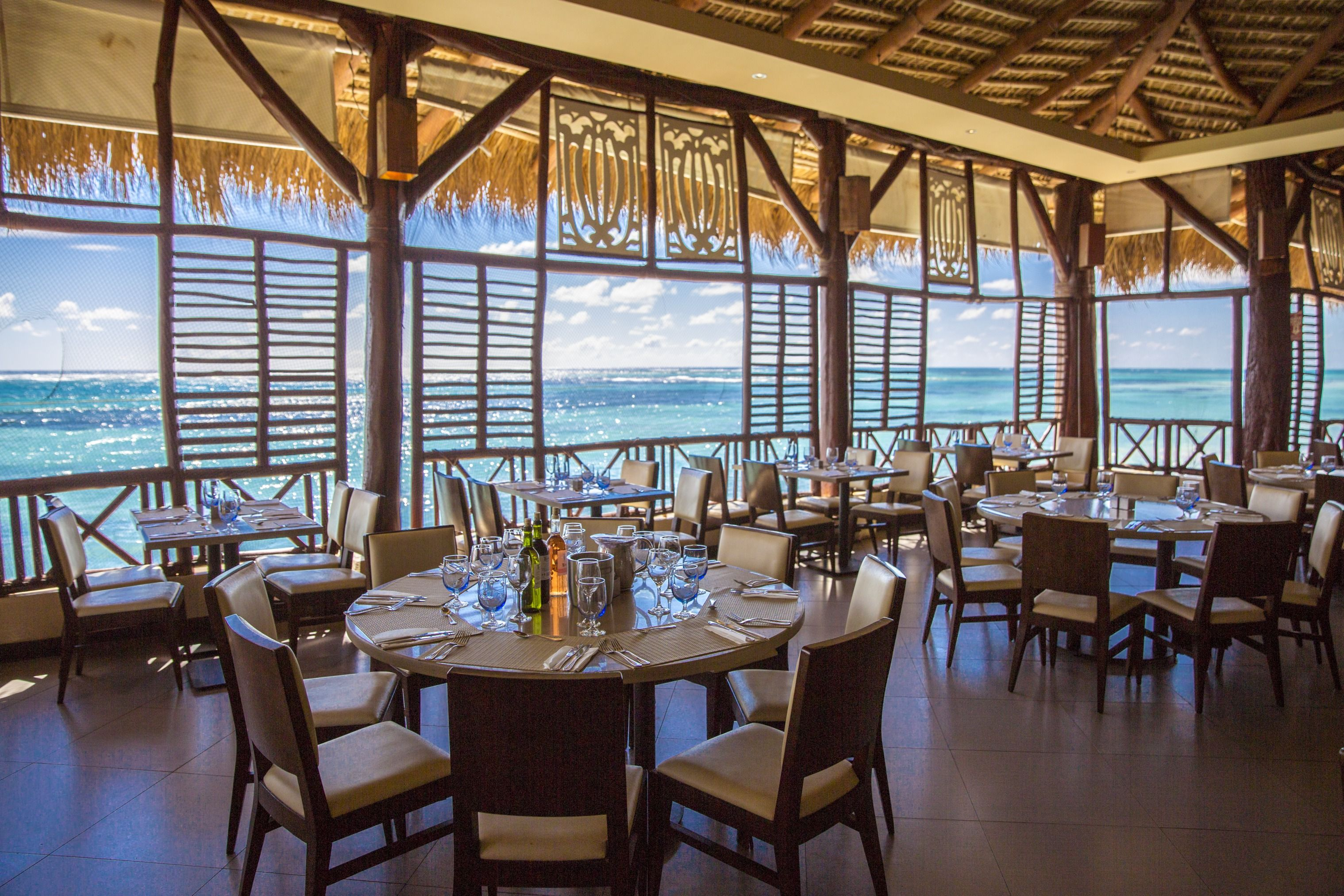 the turquoise waters of the sea lie at the foot of this restaurant