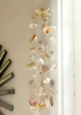 Love seashell mobiles....saw a bunch at a friend's house long ago and thought what a great use of all our shells. Something to work on...would be cute in the sunroom/playroom