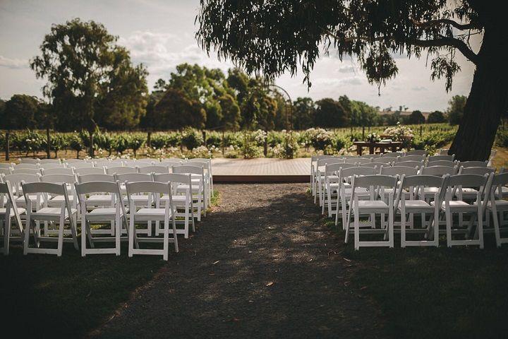 Outdoor wedding ceremony setting in wineyard #rusticwedding #weddingceremony