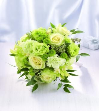 Green cymbidium orchids green roses carnations and button poms