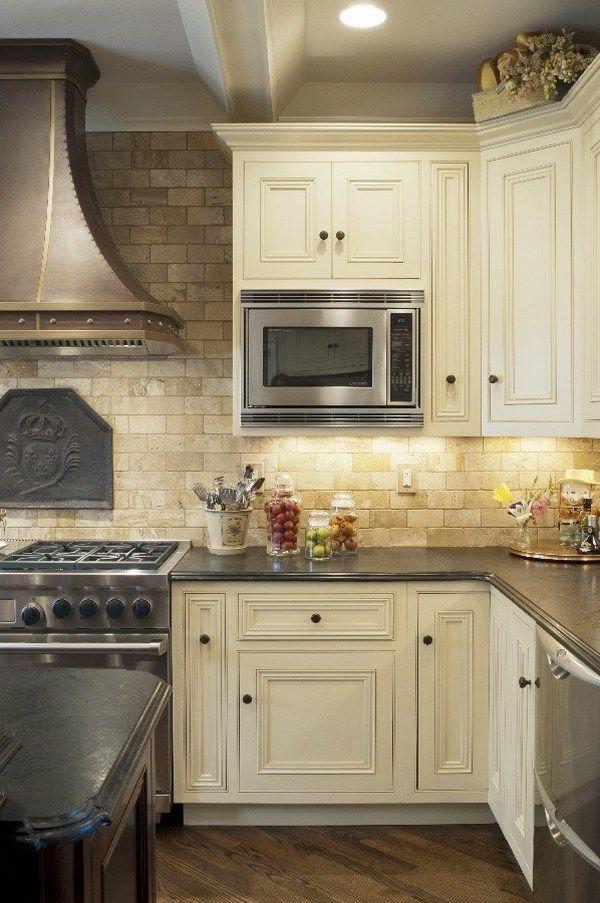 Travertine Kitchen Backsplash What Is The Best Way To Unclog A Sink Mediterranean Design Tile White Cabinets Wood Flooring