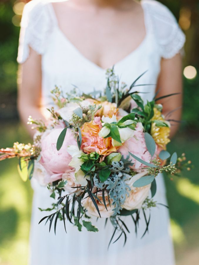 This Colorful Maui Wedding is a Boho Bride's Dream | bohemian waterfront wedding | bright and natural bridal bouquet with pops of peach pink yellow and green | pastel bouquet