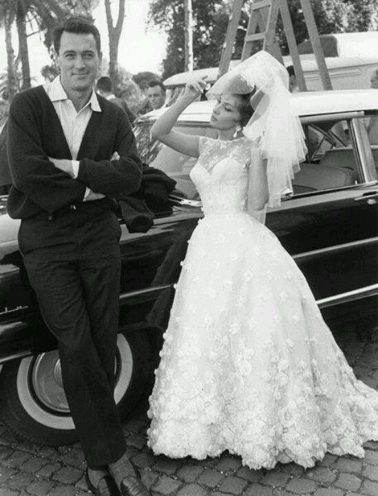 """Rock Hudson and Gina Lollobrigida with a 1957 Lincoln on location for """"Come September,"""" 1961."""