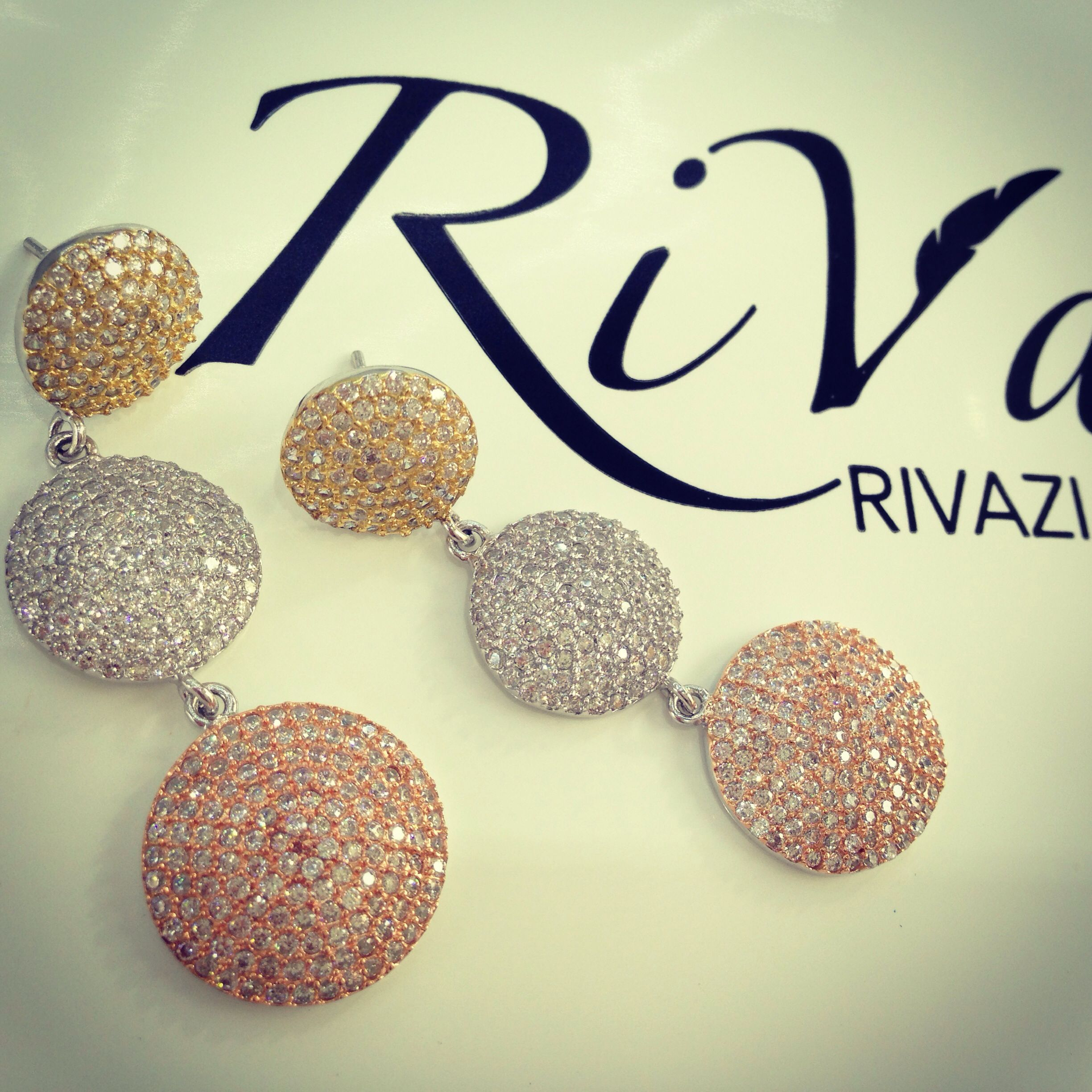 RiVazi Three Tone Miraje earrings are made to match any style and preference. Constructed from sterling silver, dipped in gold and rose gold with a detailed cubic zirconia embellishment.