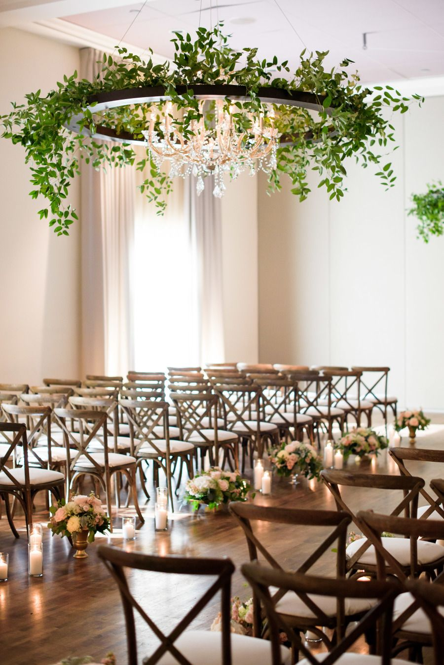 Urban Garden Wedding With Greenery Covered Chandeliers Wedding Chandelier Garden Weddings Ceremony Ceremony Candles