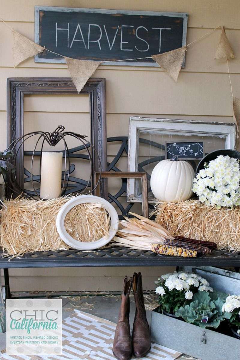 thrifty finds such as a metal pumpkin candle holder and shabby chic frames blend in with season touches in this fall harvest display