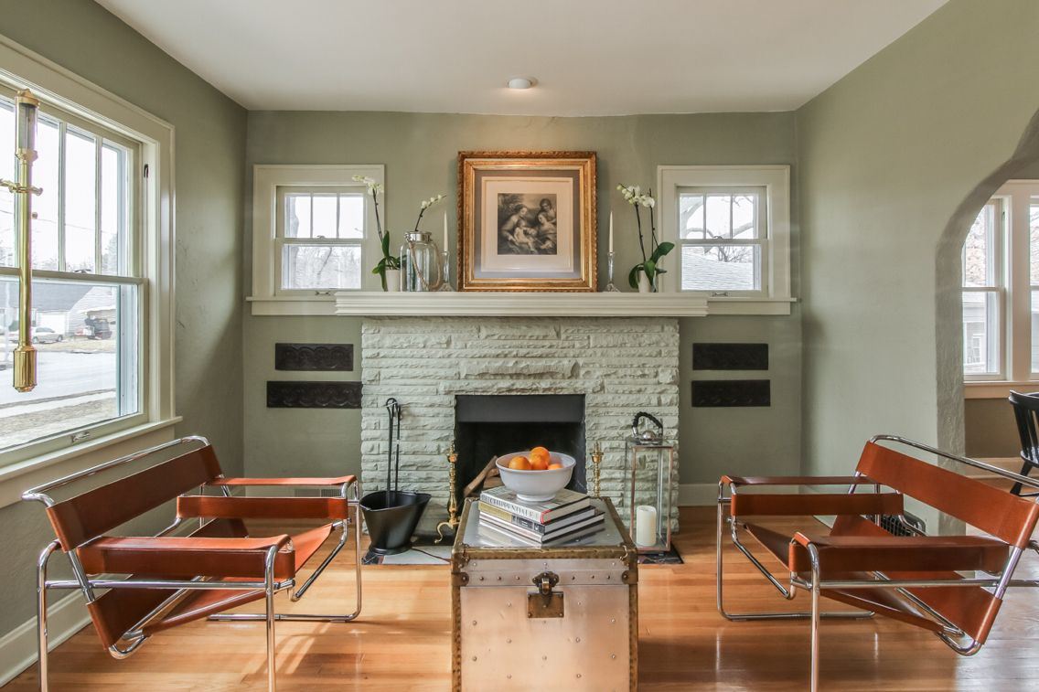 Stunning sage green in the classic and modern living room ...