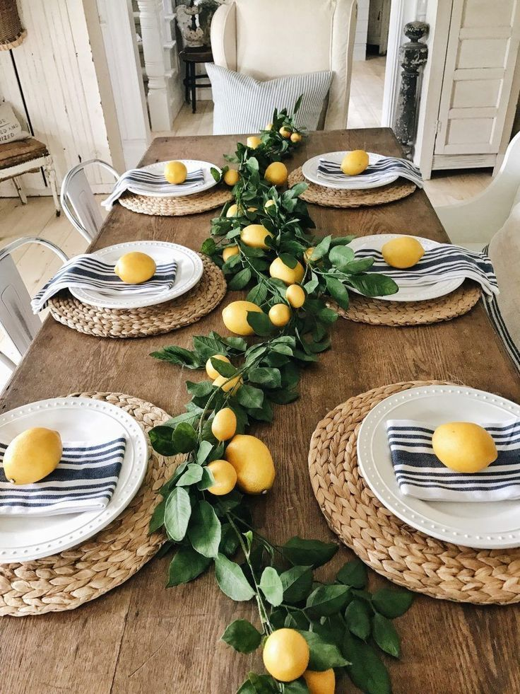 Photo of Cute dining room table decor with lemons. Yellow, tan, and green