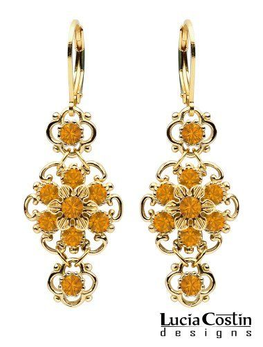 European Inspired Dangle Flower Earrings by Lucia Costin with Twisted Lines and Dots, Adorned with Yellow Swarovski Crystals; 24K Yellow Gold Plated over .925 Sterling Silver Lucia Costin. $66.00. Enriched with topaz Swarovski crystals. Produced delicately by hand, made in USA. Dangle earrings by Lucia Costin. Unique and feminine, perfect to wear for special occasions and evenings. Create a delicate and romantic look