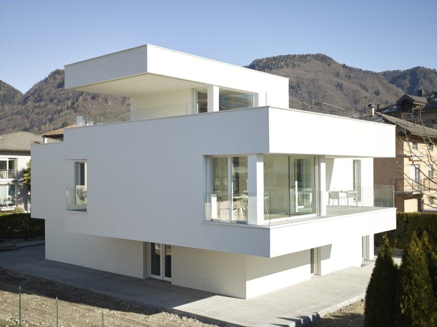 The roof of the second story was transformed into a veranda that wraps around the top of the house, offering a 360-degree view of the breathtaking mountain landscape. The exterior of the house was painted white not only to showcase the house but also to help the neighboring houses colors stand out in comparison.