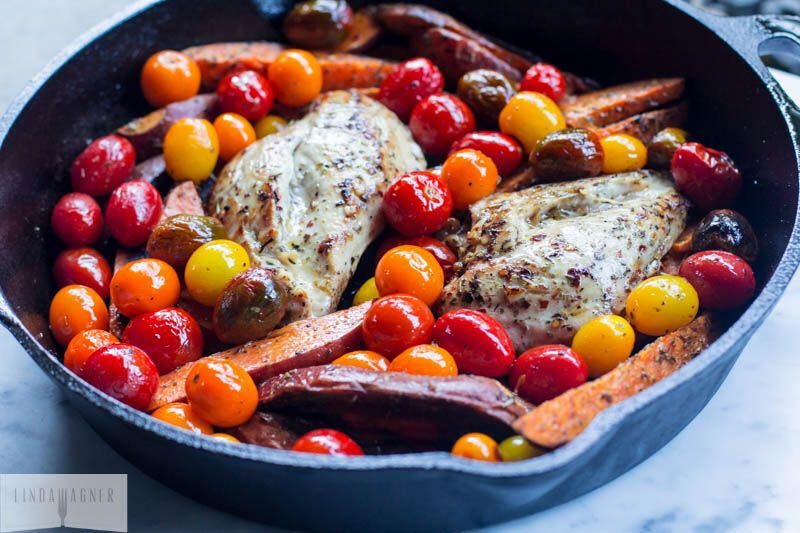 2 chicken breasts (free-range organic is preferred) 2 large sweet potatoes, washed and cut into wedges (I left the skin on) 1 pint assorted grape tomatoes 4 large cloves of garlic, minced (you can use more or less according to taste) 2 Tbs Italian seasoning 1/2 tsp red cracked pepper sea salt olive oil