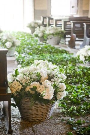 Fabulous  flowers i like them in the baskets beside the pews. Could double as gifts for wedding party as take home.