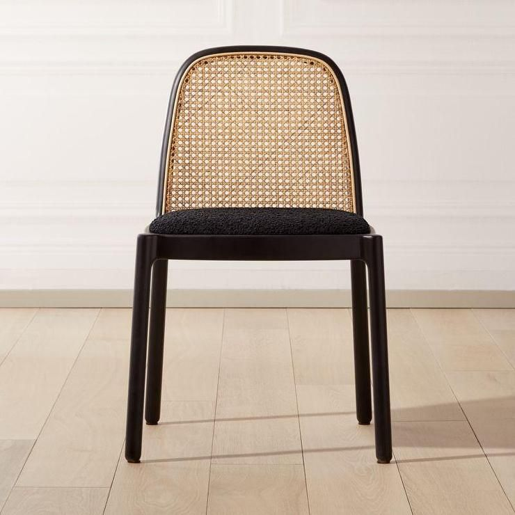 Seating A Modern And A Little Glam Take On The Classic Cane Chair Jannis Ellenberger Pairs Natural Rattan Wit Black Dining Chairs Cane Chair Dining Chairs