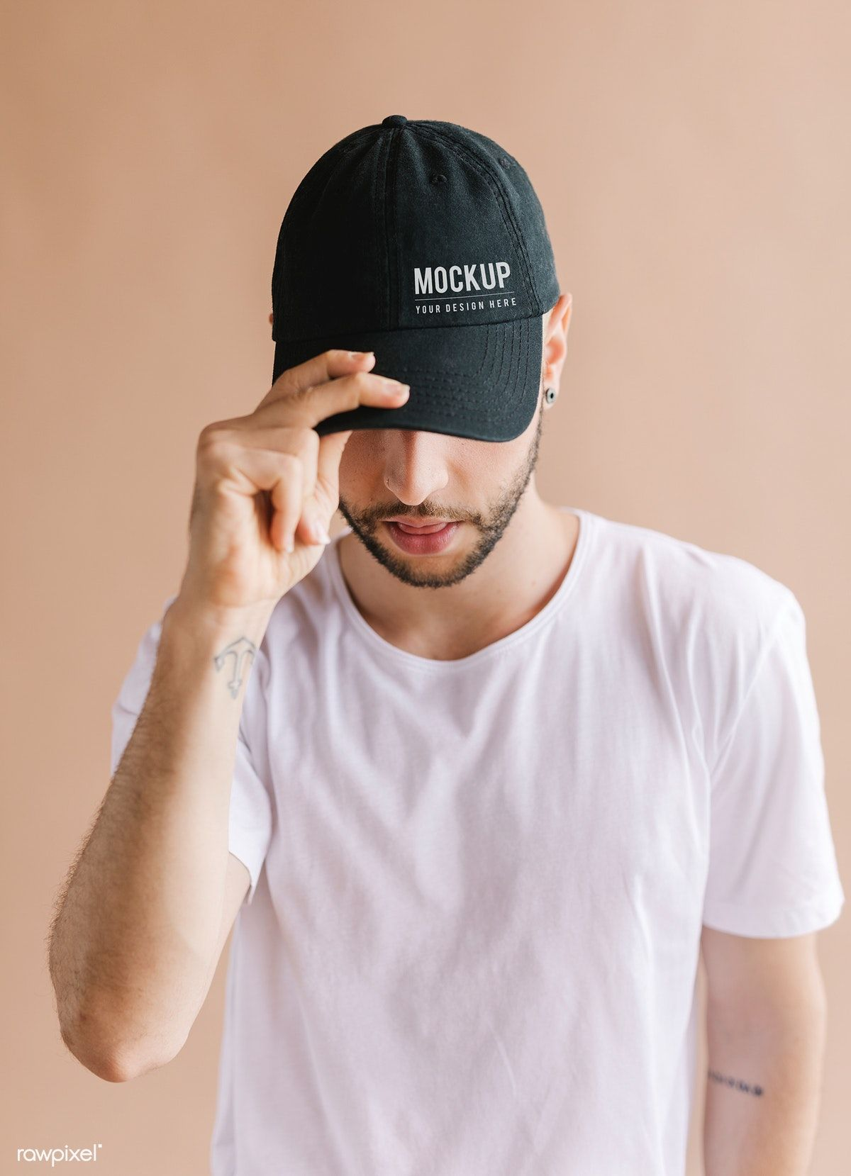 Download Premium Psd Of Man With A Black Cap Mockup 1235598 Black Cap Grey Long Sleeve Shirt Shirt Mockup