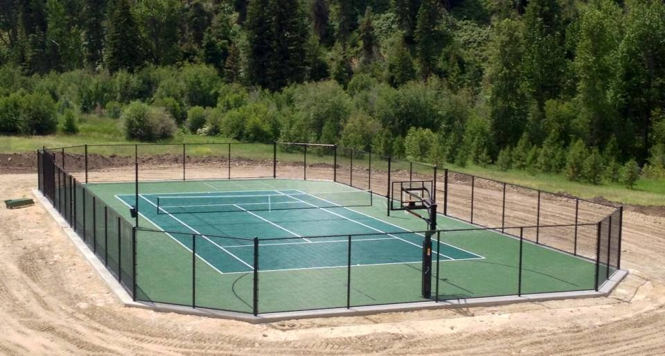 Tennis Court Construction Featuring Custom Design Fence Court Surface Basketball Goal And Striping A Var Backyard Sports Tennis Court Backyard Backyard Court