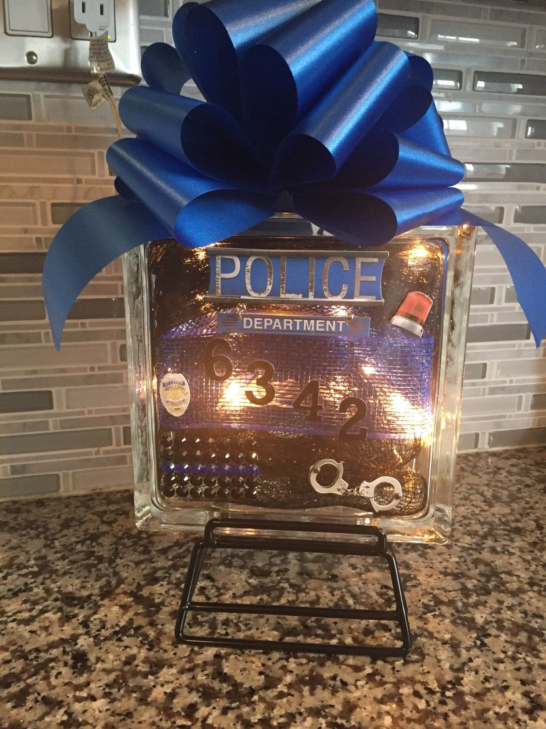 A personal favorite from my Etsy shop https://www.etsy.com/listing/455942000/personalized-glass-block-police-thin