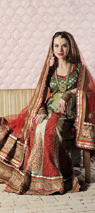 69426:  #Tabu walked the ramp for Designer Anju Modi at #Delhi Couture Week. Similar here.