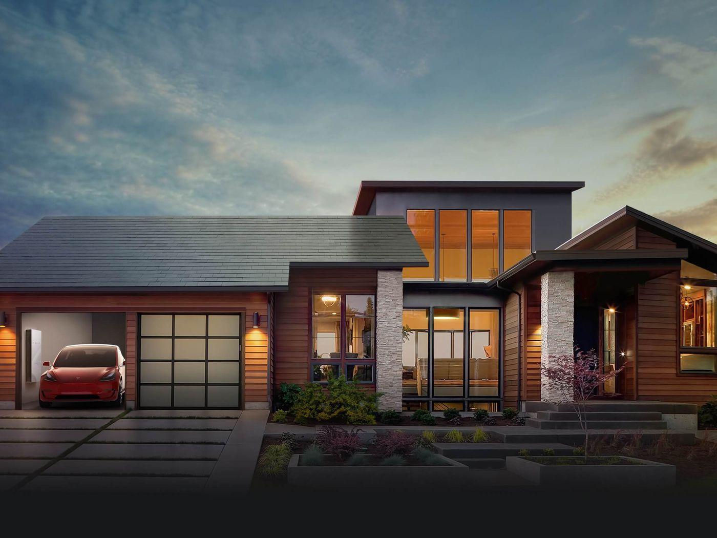 Casa com um telhado solar e um veículo elétrico na garagem, ambos da companhia Tesla Inc., do milionário Elon Musk. (Foto: Tesla)