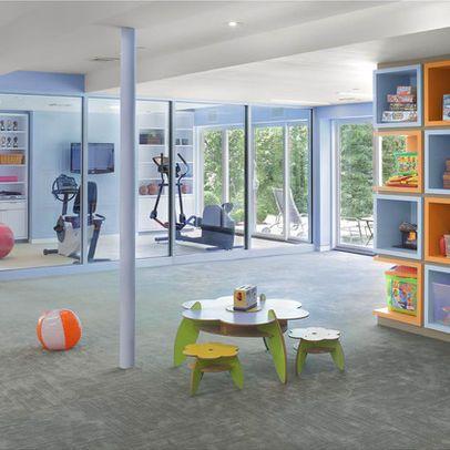 glass panel wall exercise room  home gym design basement