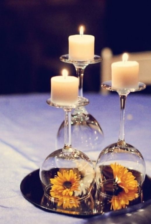 Repurpose wine glasses into candle holders for a clever centerpiece. #wine #DIY
