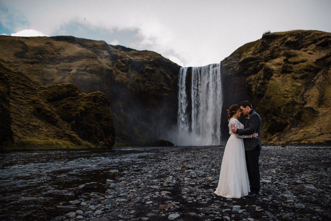 Skógafoss waterfall wedding portrait. Iceland wedding photographer