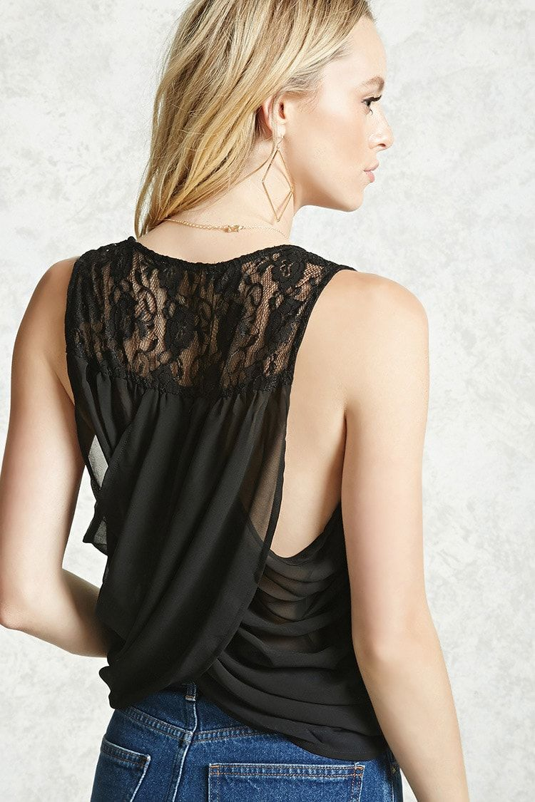 A sleeveless woven top featuring a self-tie front, round neckline and lace detailing at the back with draped tulip layers.
