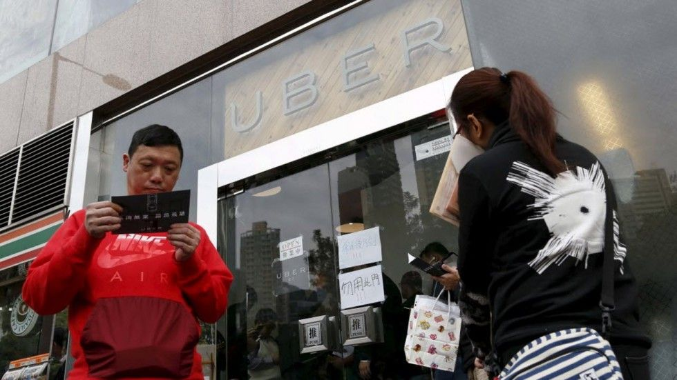 The flag falls: Seven Uber drivers in Hong Kong face driving charges The Uber office has once again become the centre of attention. Photo: Reuters