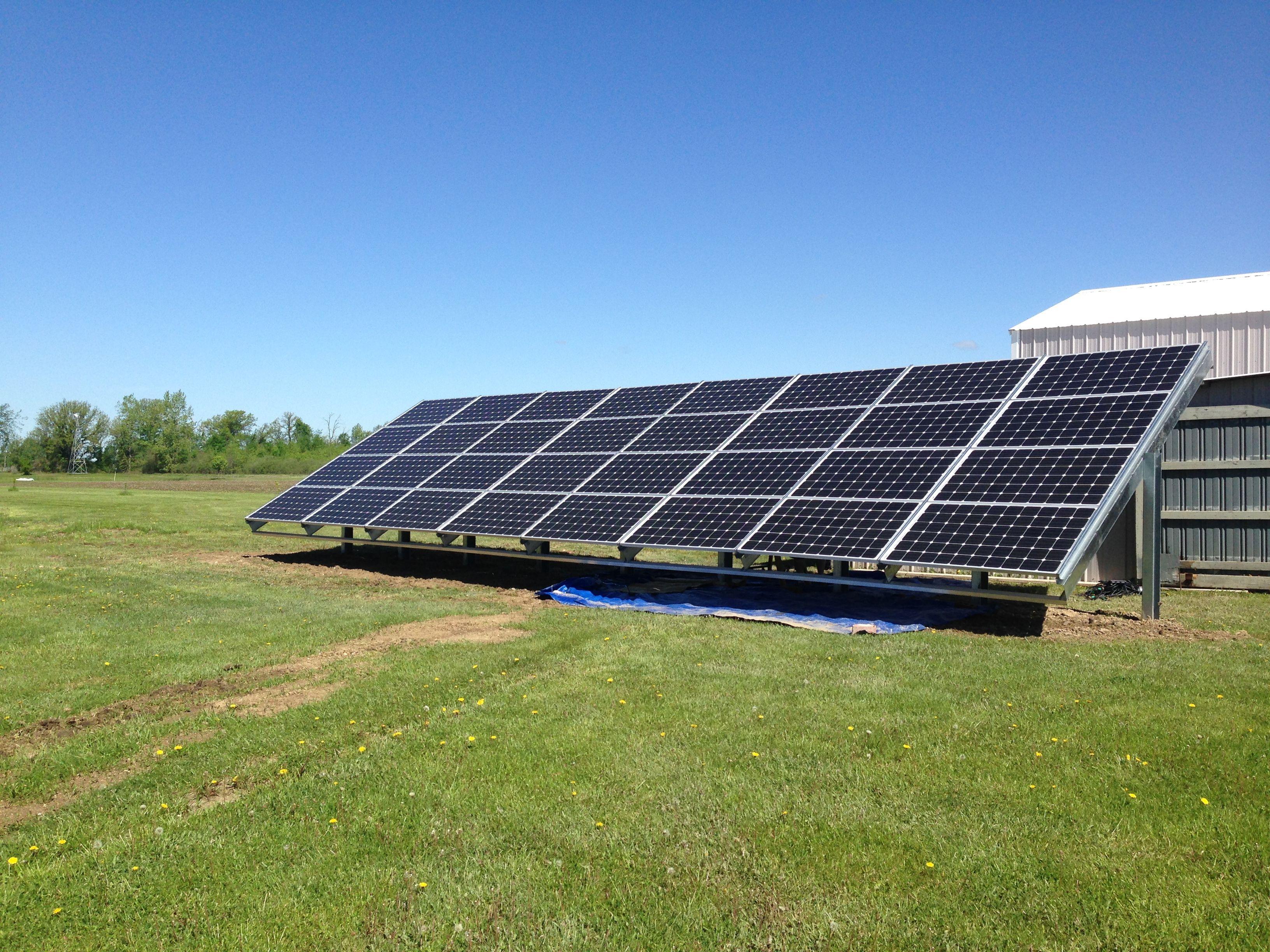 Newport Michigan Ground Mount Solar Array Using Patriot Solar Group S Racking 32 270w Solarworld Panels 32 Solar Panels Design Solar Solar Panel Battery