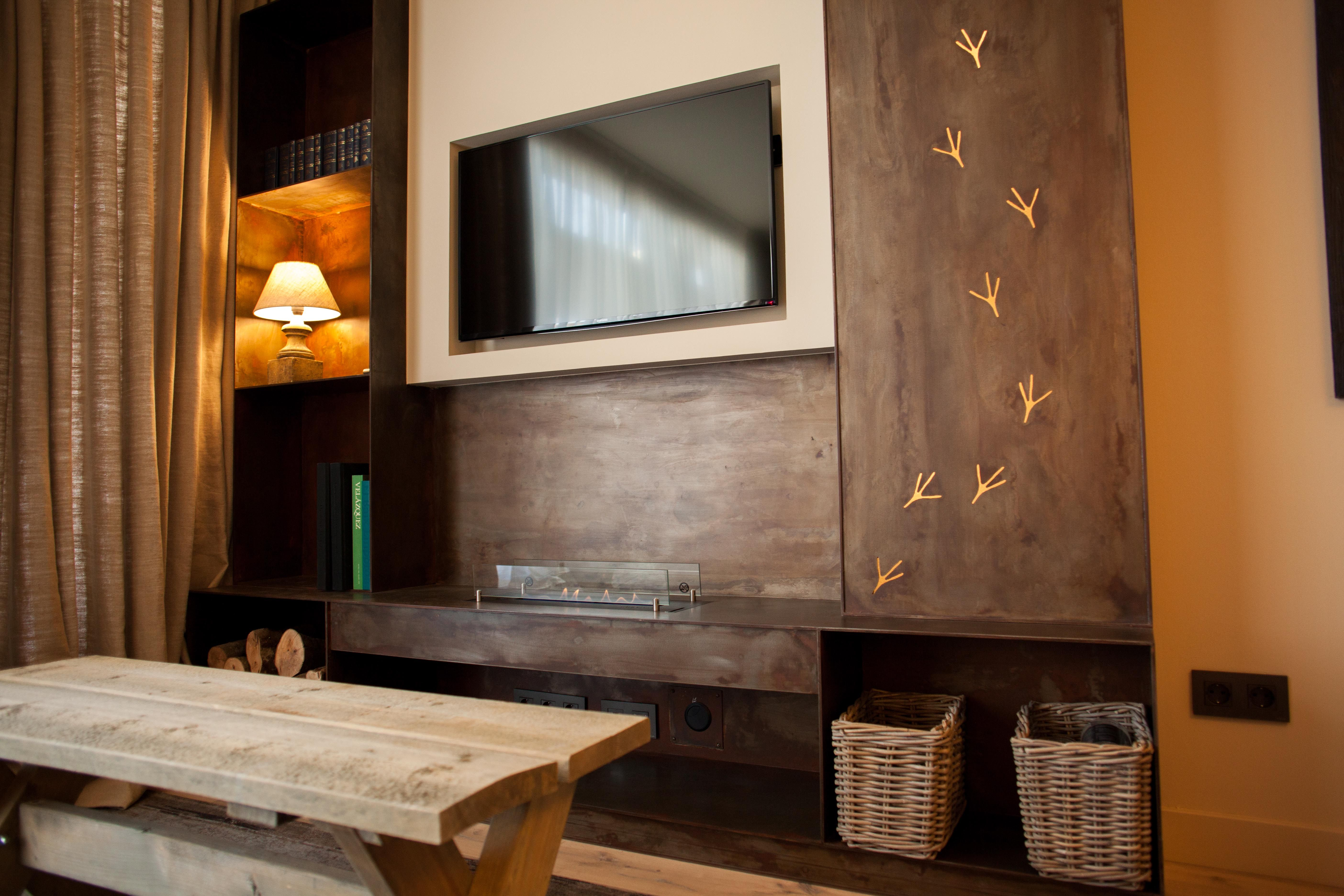 Corten Steel Wall Unit With Ecological Fireplace Design By Lory