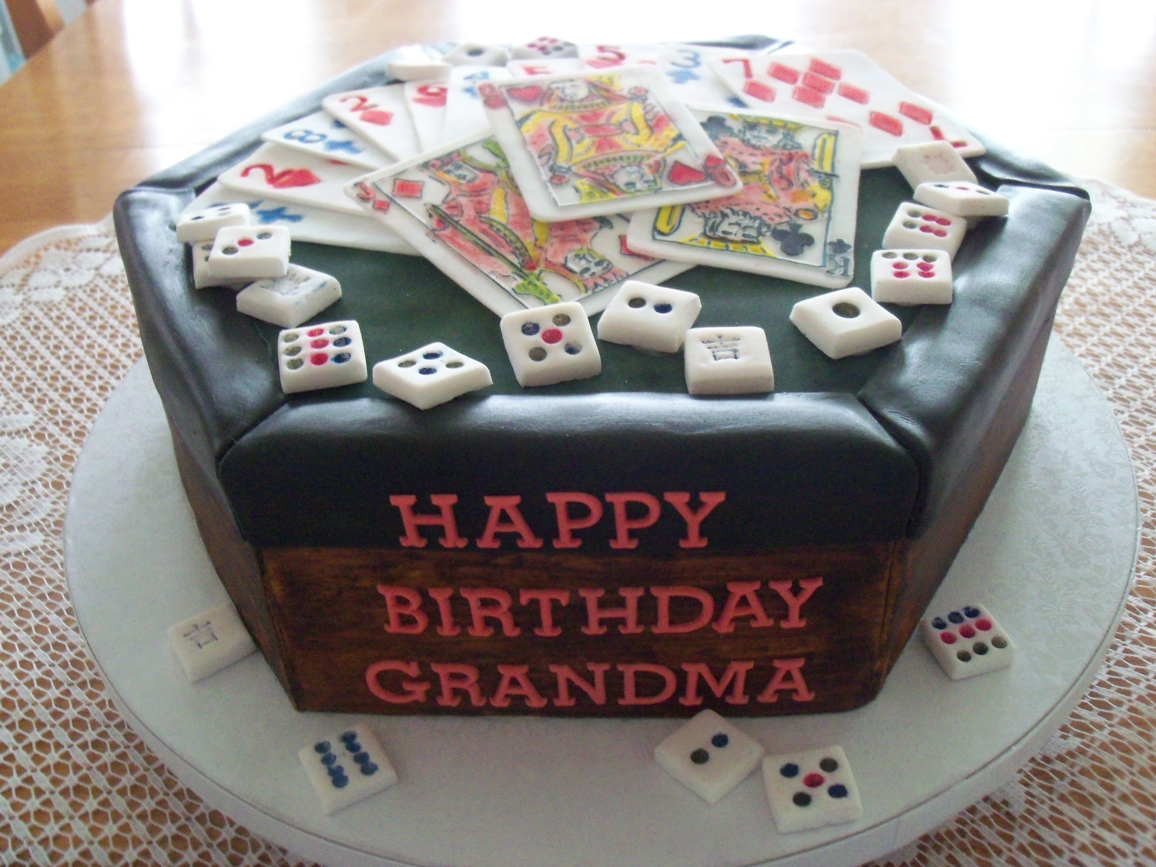 This cake was for a card and Mahjongg player.  The card values add up to her age of 83.  Everything is fondant, just slice and enjoy!!