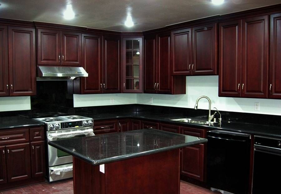 dark kitchen cabinets with dark countertops cherry wood kitchen cabinets cherry cabinets on kitchen remodel dark countertops id=33291