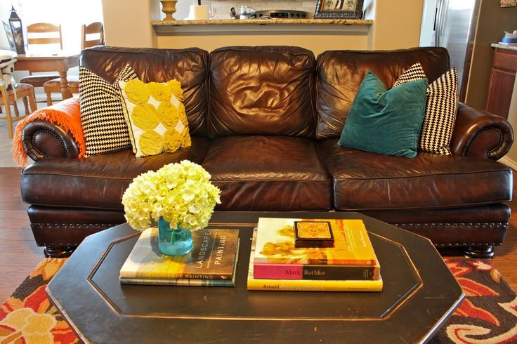 Brown Leather Couch With Yellow And Teal Accents Found On Homestoriesatoz Com Living Room Yellow And Brown Brown Living Room Brown Sofa Living Room