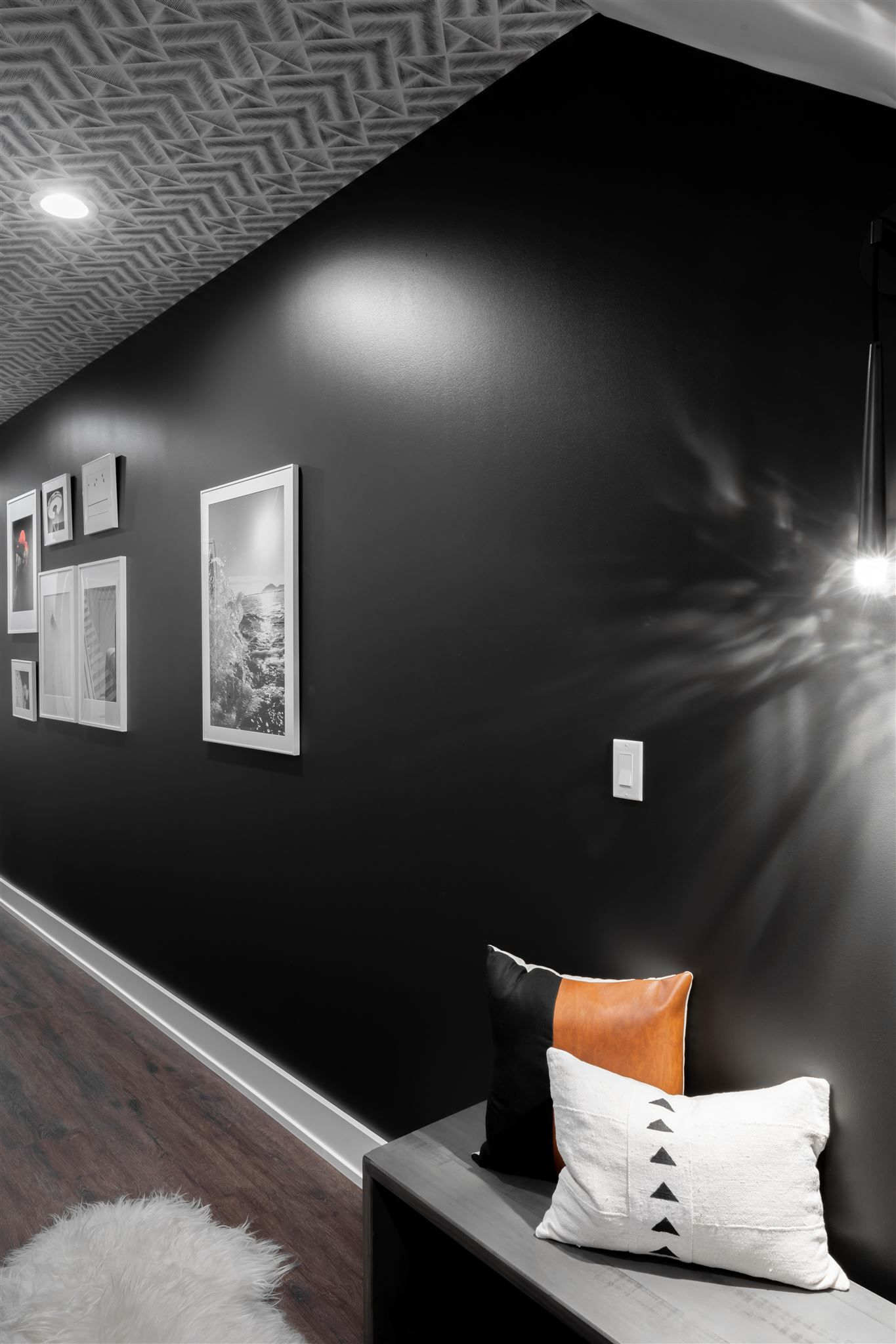 In The Basement Hallway A Black Accent Wall And The Wallpapered Ceiling Create A Black Accent Wall Living Room Accent Walls In Living Room Black Accent Walls