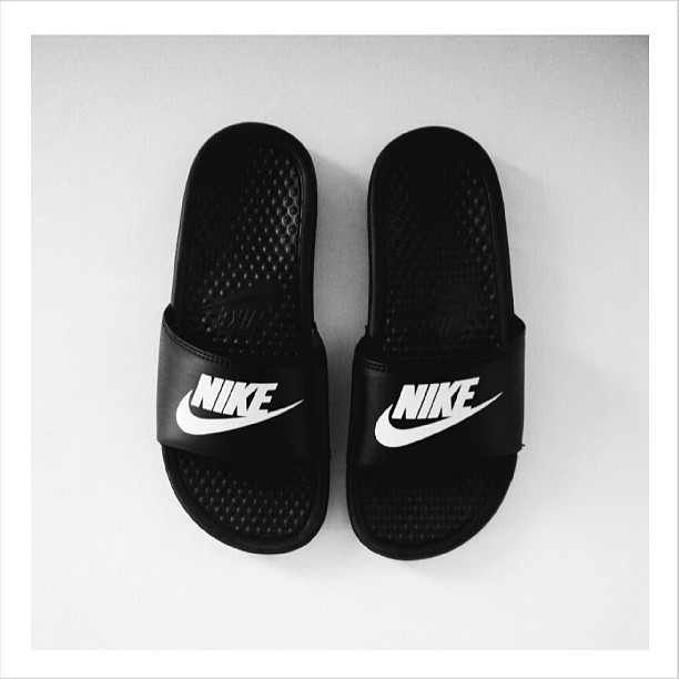 This is a picture of nike golf sandals. I wear socks and sandals on a regular basis. It is a sub-culture that I am apart of. Socks and sandals is getting more popular.