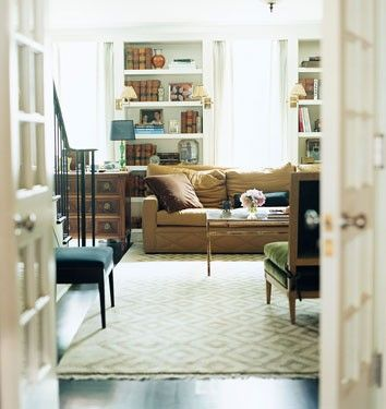 Nate berkus traditional living room with camel sofa and library