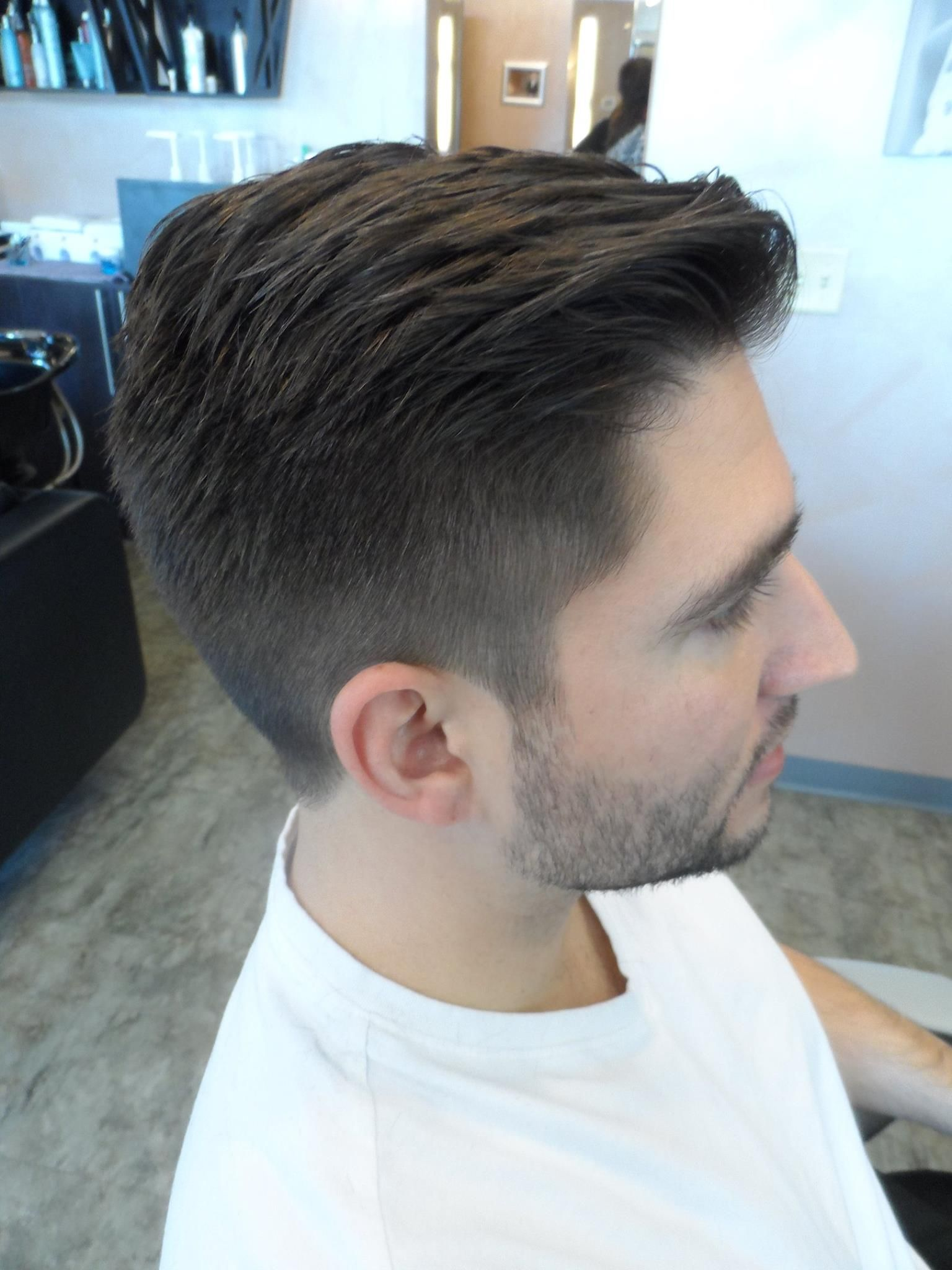 Soft fade mens haircut with low rise pompadour by Erin Conn