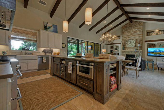 Notice beams l shaped kitchen kitchen to dining to for Open floor plan metal homes