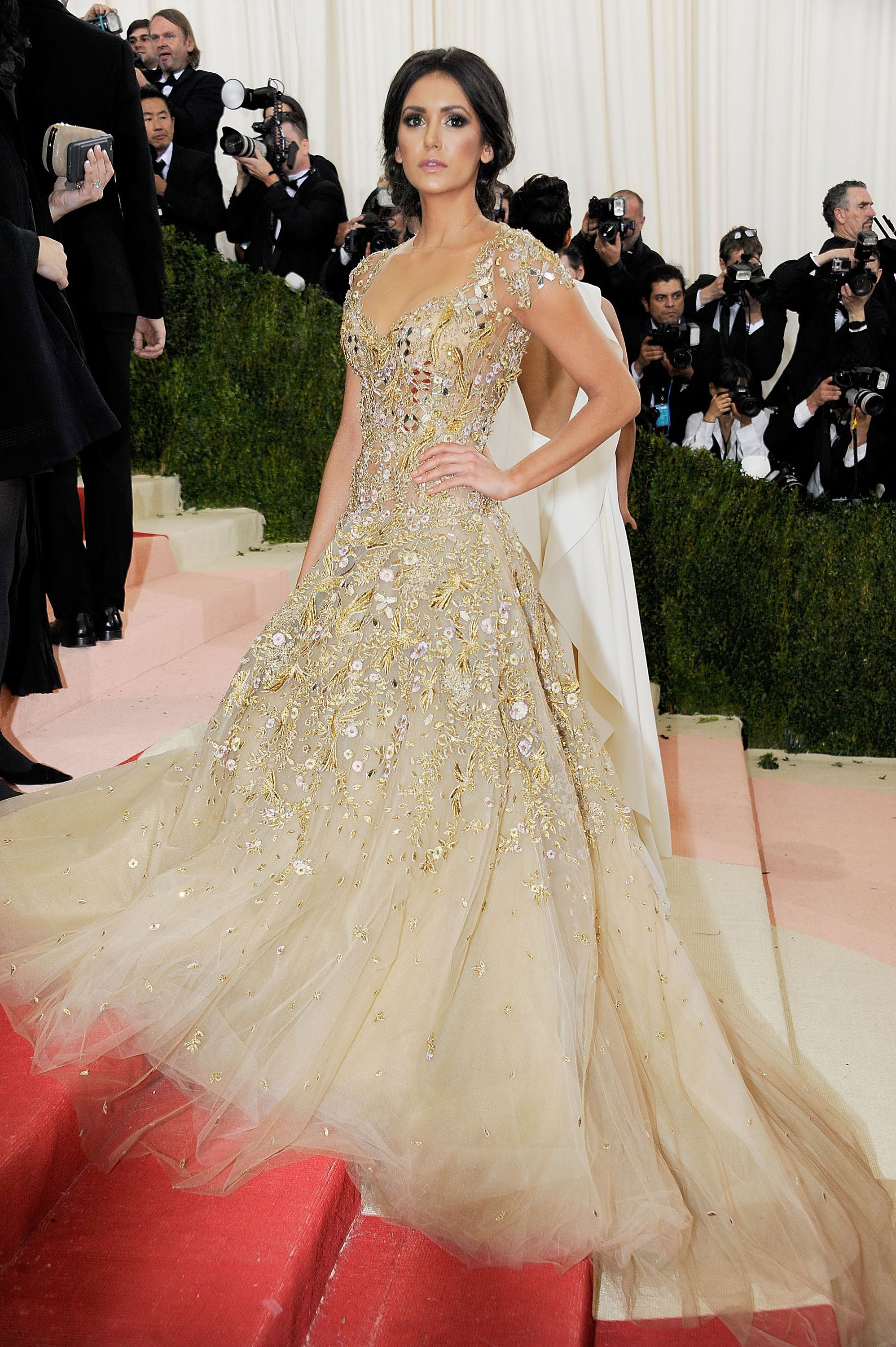 Nina Dobrev at the 2016 met gala wearing Marchesa. #GoldGown #Marchesa  #MetBall #redcarpet