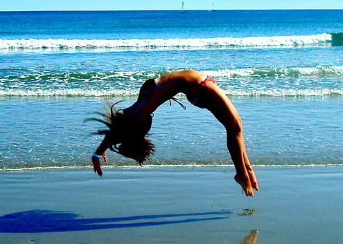 0d24e0752 Doing Back flips on the Beach. Yes she sure would!!!