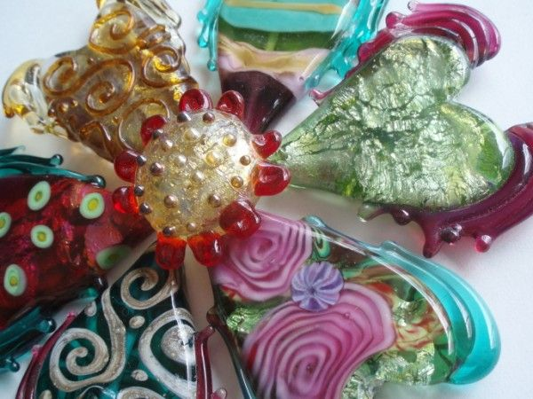 A series of glass hearts by Maureen Nugent.  www.beadoire.com