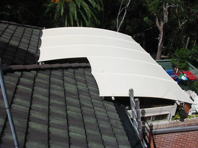 Roof mounted patio cover.