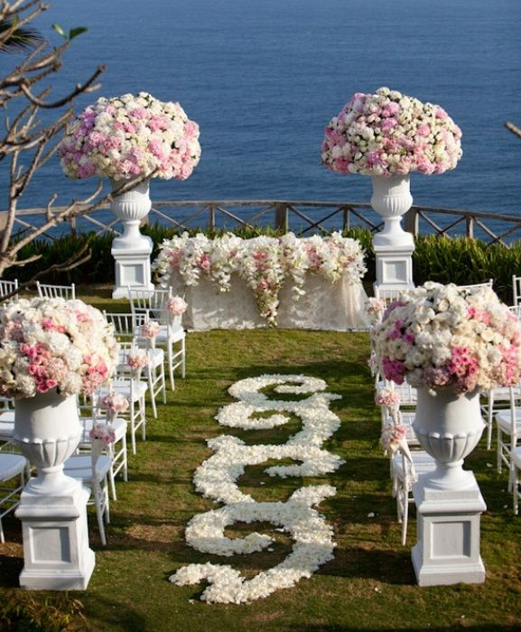 Victorian inspired wedding beach flower garden ceremony huge lush floral arrangements make this outdoor wedding ceremony total eye candy white and blush pink wedding ceremony photo samuel lippke junglespirit Images