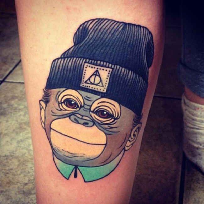 Tattoo cartoon monkey with cap tattoo tattooed for Small cartoon tattoo designs