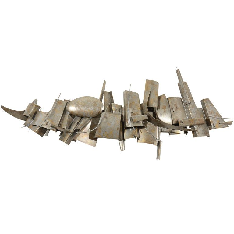 Wall Sculpture Lighting by Roger Feraud   From a unique collection of antique and modern wall lights and sconces at https://www.1stdibs.com/furniture/lighting/sconces-wall-lights/
