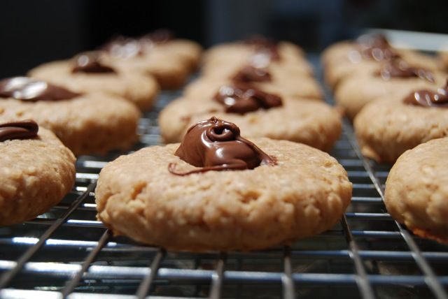 Peanut Butter Thumbprint Cookies, filled with Nutella!  What a concept!