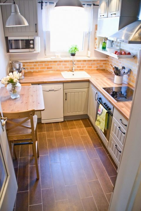 tiny kitchen makeover with painted backsplash and wood tile floors