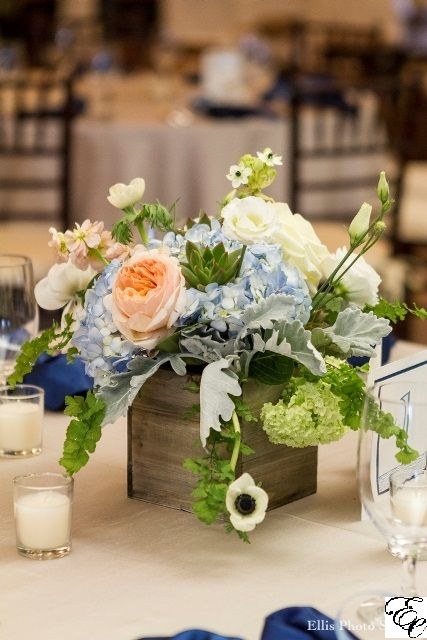 Wood box centerpiece with peach green and blue flowers