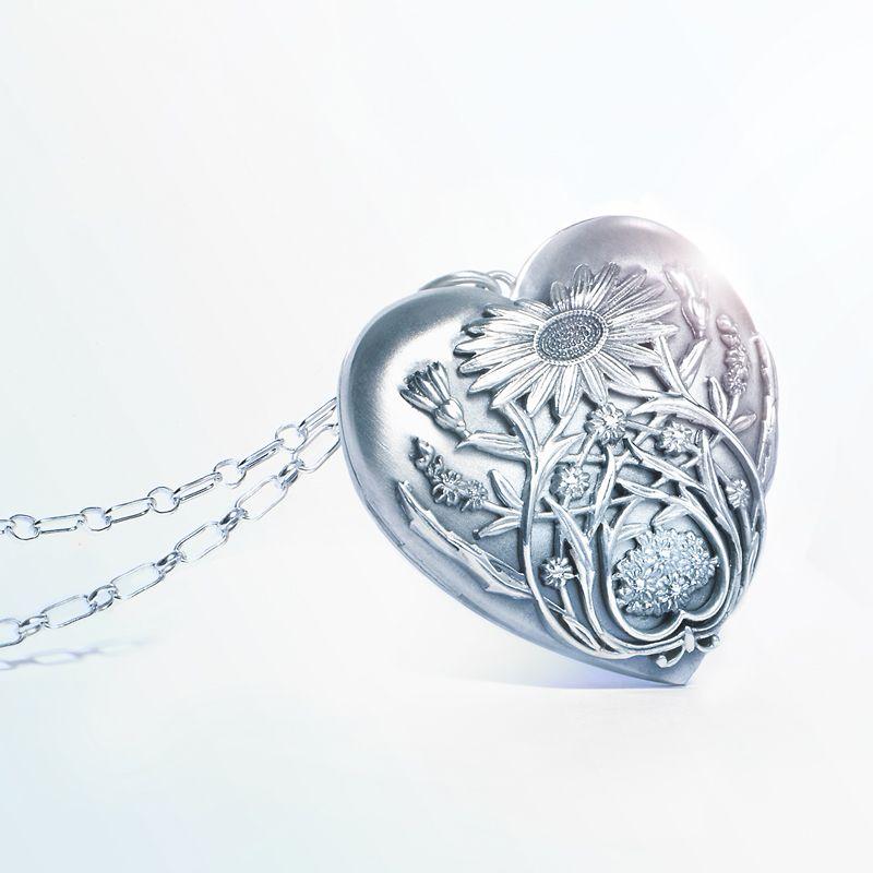 5c59c789799 Tiffany   Co. Ziegfeld Collection daisy locket in sterling silver.   TiffanyPinterest